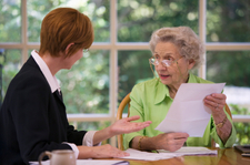 Senior woman meeting with attorney