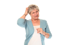 Senior older woman scratching head